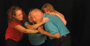 The River Crossing Playback ensemble plays a scene of forgiveness  in Playback Theatre.